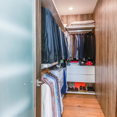 Sophisticated primary walk-in closet