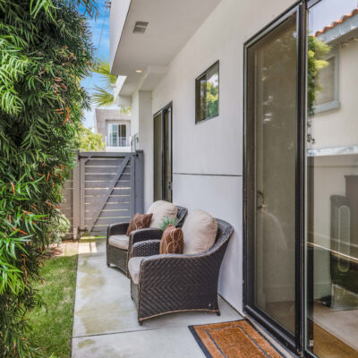 Side patio off of ground level bedrooms