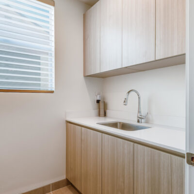 Laundry room with sink and storage