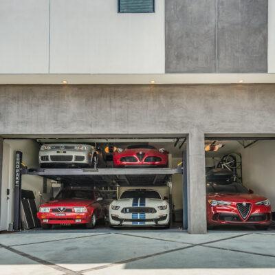 3 car side by side garage with 2 car hydraulic lift